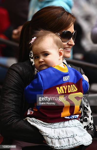 Kylie the wife of Jonathan Brown and their daughter Olivia watch on during the round 21 AFL match between the Essendon Bombers and the Brisbane Lions...