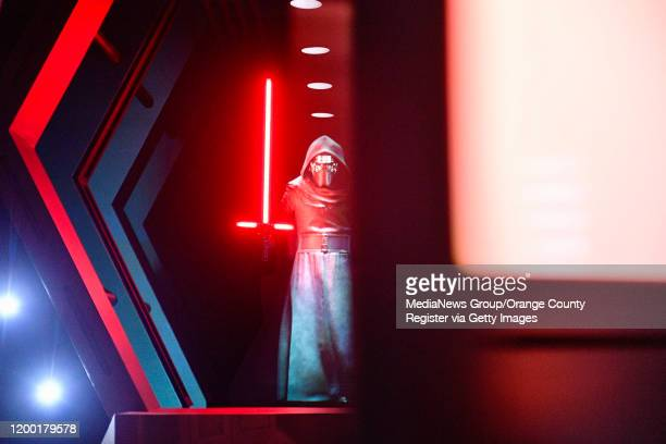 """Kylo Ren chase after visitors as doors close on him aboard a Star Destroyer during Rise of the Resistance at Star Wars: Galaxy""""u2019s Edge inside..."""