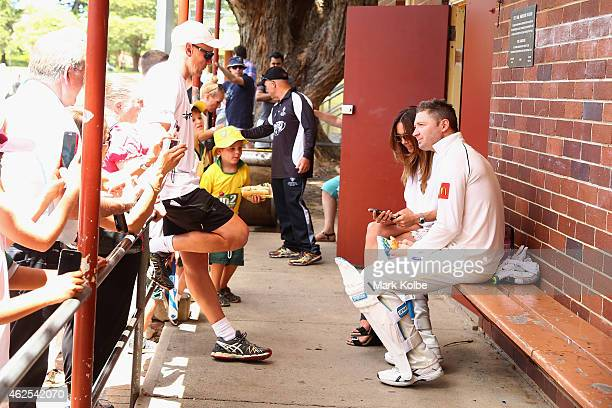 Kyly Clarke sits with her husband Michael Clarke of Wests outside the dressing rooms during the lunch break as he bats in the Sydney Grade game...