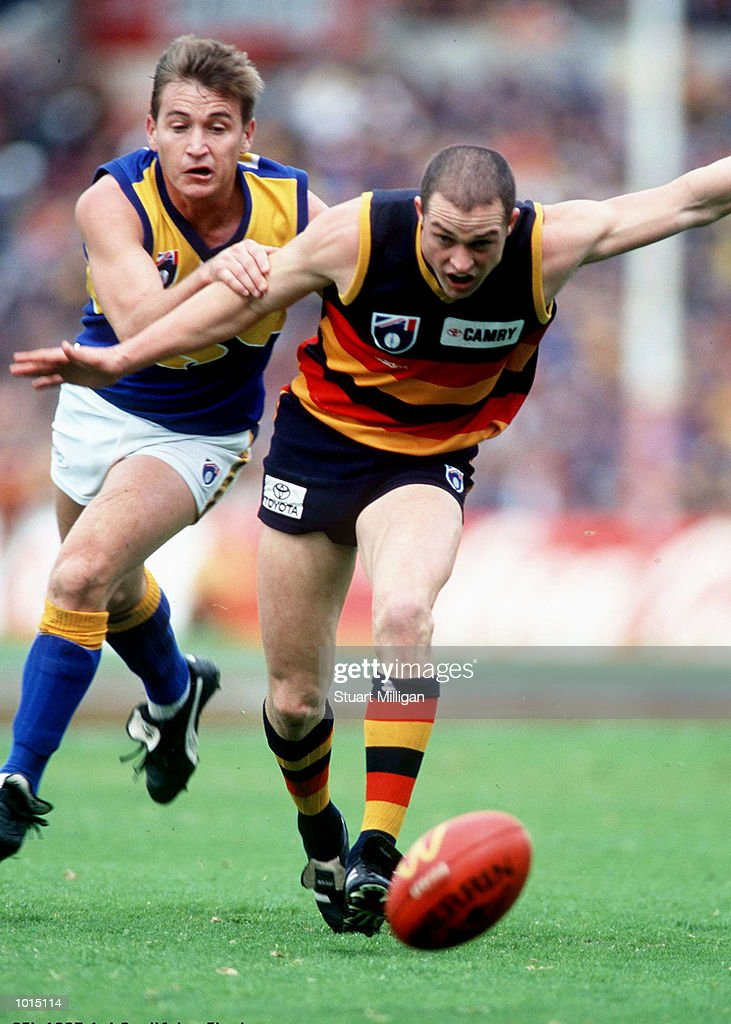 Kym Koster of Adelaide leads Tony Evans of West Coast to the ball, in the AFL 1st Qualifying Final match between the Adelaide Crows and the West Coast Eagles, played at Football Park, Adelaide, Australia. Mandatory Credit: Stuart Milligan/ALLSPORT