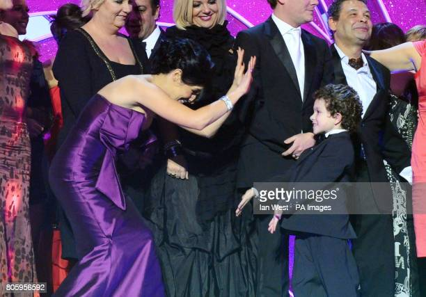 Kym Marsh and Alex Bain high five as members of the Coronation Street cast collect the best Serial Drama award during the National Television Awards...