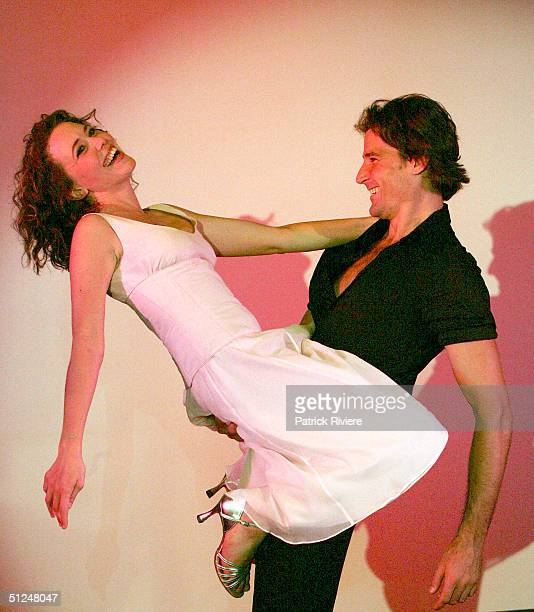 Kym Valentine and Josef Brown pose at the photocall for the stage world premiere of 'Dirty Dancing' at the Tattersall Club August 31 2004 in Sydney...