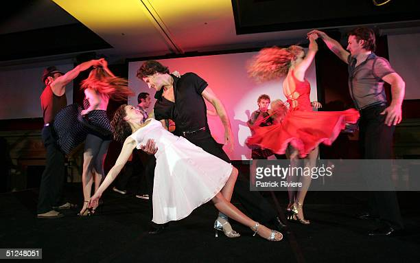 """Kym Valentine and Josef Brown pose at the photocall for the stage world premiere of """"Dirty Dancing"""" at the Tattersall Club August 31, 2004 in Sydney,..."""