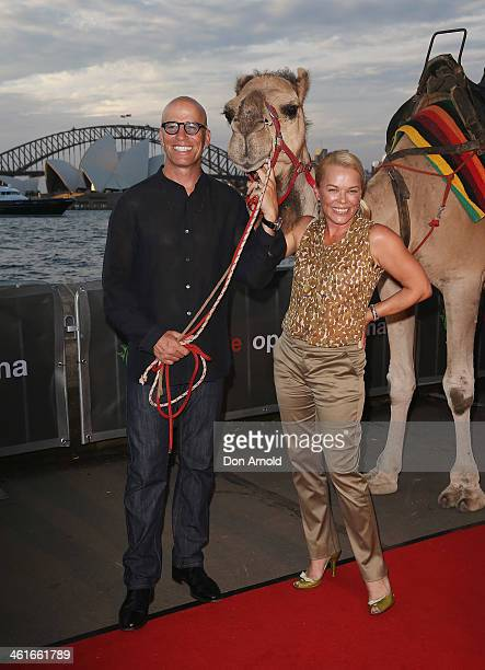 Kym Wilson poses alongside a camel at the St George Openair Cinema Tracks premiere on January 10 2014 in Sydney Australia