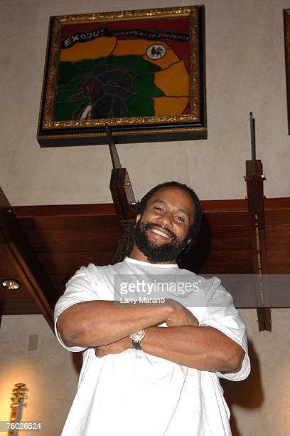 Mani Marley poses inside the Hard Rock Cafe under a peice of Bob Marley art work at The Seminole Hard Rock Hotel Casino on June 9 2007 in Hollywood...