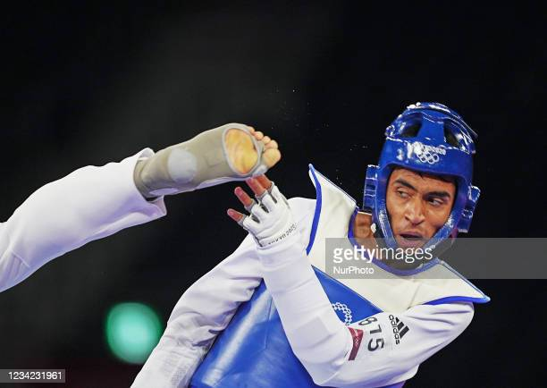 Kyo Don Inn from South Korea and Farzad Mansouri from Afghanistan during Taekwondo at the Olympics at Makuhari Messe Hall A, Tokyo, Japan on July 27,...