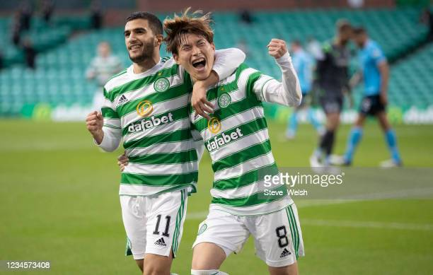 Kyogo Furuhashi of Celtic celebrates his 3rd Celtic goal with teammate Liel Abada during the Cinch Scottish Premiership match between Celtic FC and...