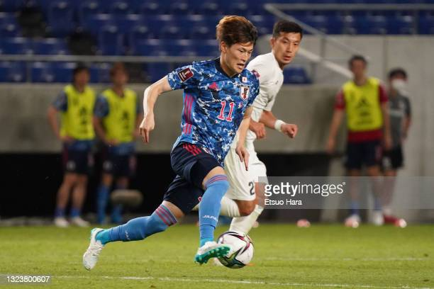 Kyogo Furuhashi of Japan in action during the FIFA World Cup Asian Qualifier 2nd round Group F match between Japan and Kyrgyz at Panasonic Stadium...