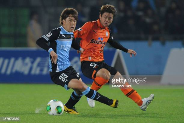 Kyohei Noborizato of Kawasaki Frontale and Genki Omae of Shimizu Spulse compete for the ball during the JLeague match between Kawasaki Frontale and...