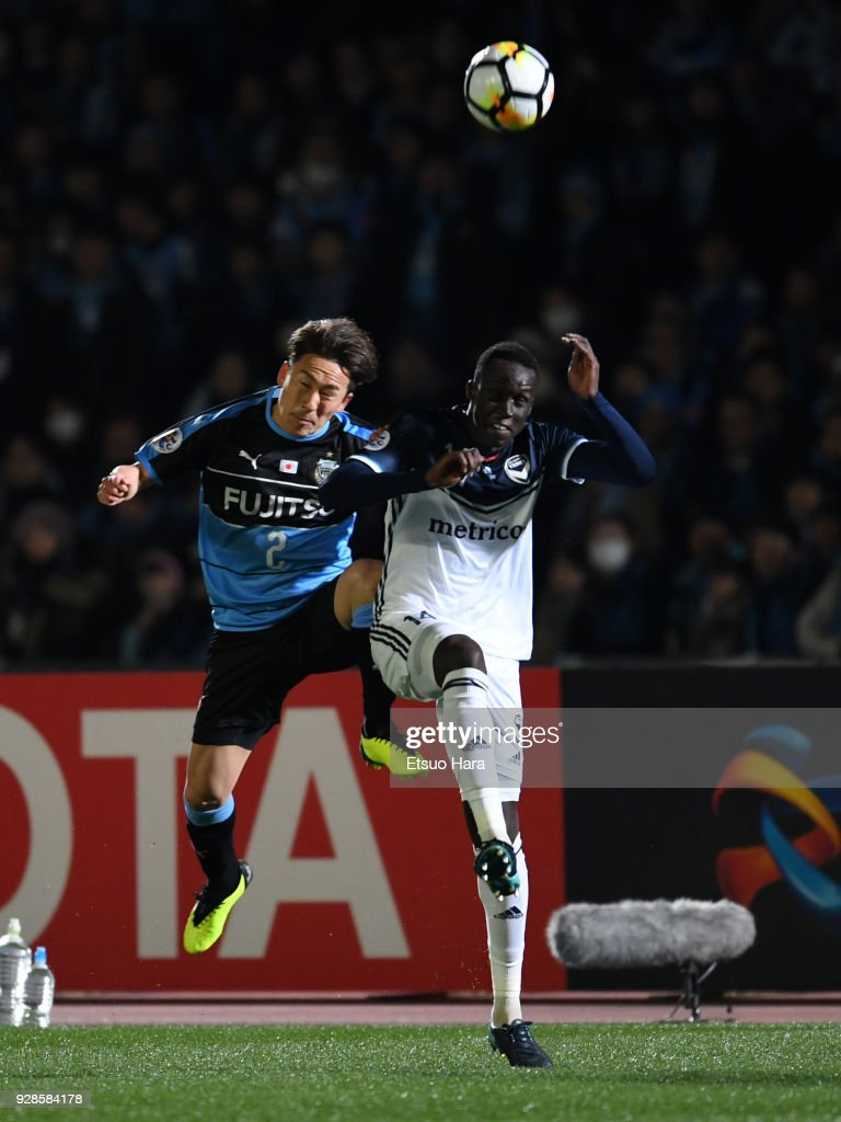 Kyohei Noborizato (L) of Kawasaki Frontale and Thomas Deng of Melbourne Victory compete for the ball during the AFC Champions League Group F match between Kawasaki Frontale and Melbourne Victory at Todoroki Stadium on March 7, 2018 in Kawasaki, Kanagawa, Japan.