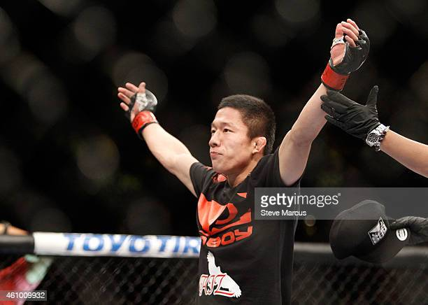 Kyoji Horiguchi celebrates after his flyweight fight against Louis Gaudinot during the UFC 182 event at the MGM Grand Garden Arena on January 3, 2015...