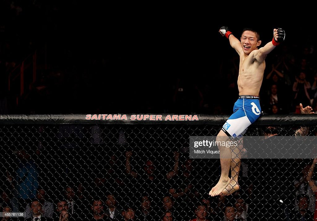 Kyoji Horiguchi celebrates his win over Jon Delos Reyes in their flyweight bout during the UFC Fight Night event inside the Saitama Arena on September 20, 2014 in Saitama, Japan.