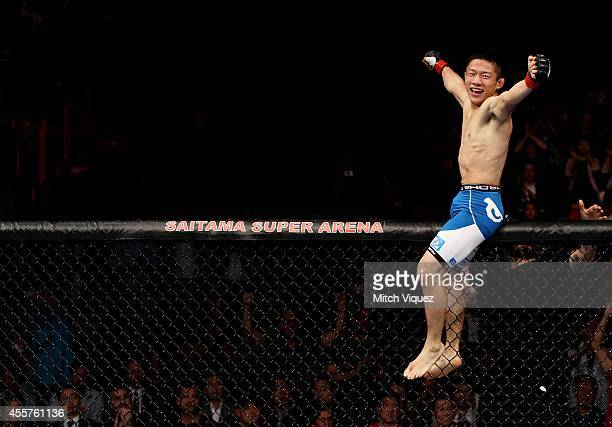 Kyoji Horiguchi celebrates his win over Jon Delos Reyes in their flyweight bout during the UFC Fight Night event inside the Saitama Arena on...
