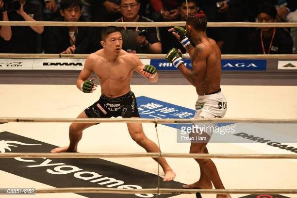 Kyoji Horiguchi of Japan and Darrion Caldwell of United States compete in the bout between Kyoji Horiguchi of Japan and Darrion Caldwell of Unites...