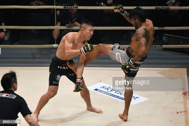 Kyoji Horiguchi of Japan and Gabriel Oliveira of Brazil compete in the bantam weight bout during the RIZIN Fighting World Grand-Prix 2017 2nd Round...