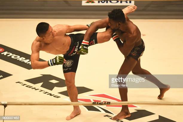 Kyoji Horiguchi of Japan and Manel Kape of Angola compete in the bantam weight GP semi-final bout during the RIZIN Fighting World Grand-Prix 2017...
