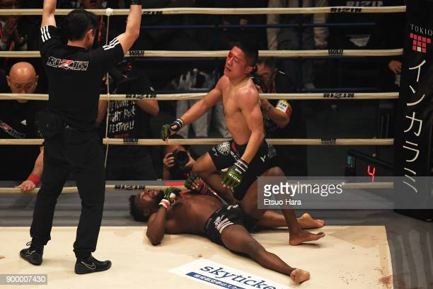 Kyoji Horiguchi of Japan celebrates his submission victory in the bantam weight GP semi-final bout against Manel Kape of Angola during the RIZIN...