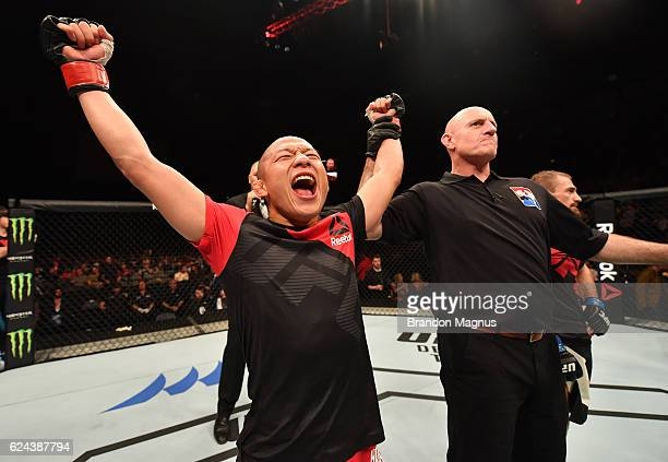 Kyoji Horiguchi of Japan celebrates his unanimous-decision victory over Ali Bagautinov of Russia in their flyweight bout during the UFC Fight Night...