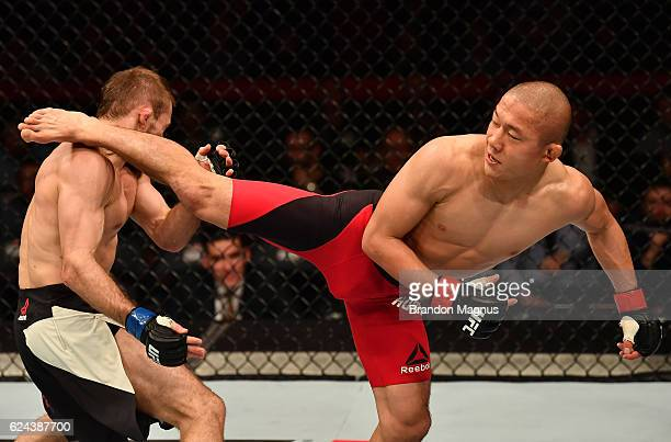 Kyoji Horiguchi of Japan kicks Ali Bagautinov of Russia in their flyweight bout during the UFC Fight Night at the SSE Arena on November 19, 2016 in...