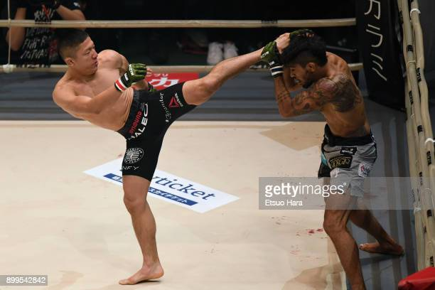 Kyoji Horiguchi of Japan kicks Gabriel Oliveira of Brazil in the bantam weight bout during the RIZIN Fighting World Grand-Prix 2017 2nd Round at...