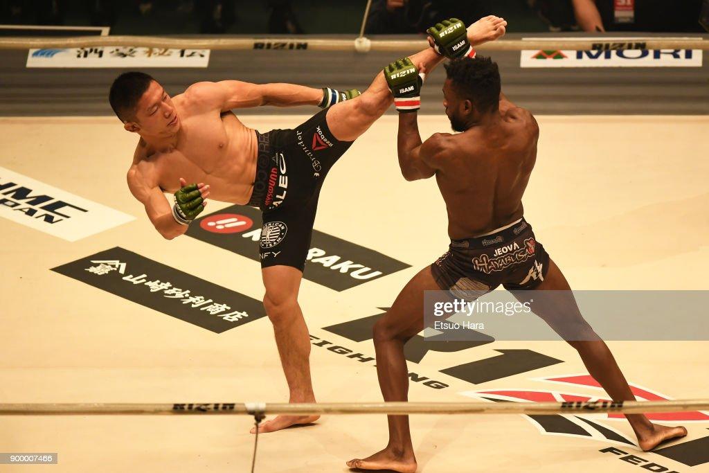 Kyoji Horiguchi (L) of Japan kicks Manel Kape of Angola in the bantam weight GP semi-final bout against Manel Kape of Angola during the RIZIN Fighting World Grand-Prix 2017 final Round at Saitama Super Arena on December 31, 2017 in Saitama, Japan.