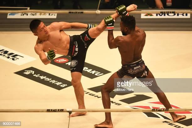 Kyoji Horiguchi of Japan kicks Manel Kape of Angola in the bantam weight GP semi-final bout against Manel Kape of Angola during the RIZIN Fighting...