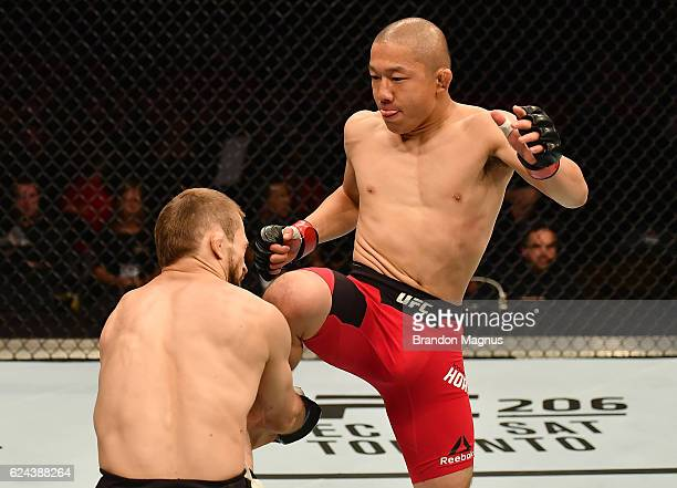 Kyoji Horiguchi of Japan lands a flying knee against Ali Bagautinov of Russia in their flyweight bout during the UFC Fight Night at the SSE Arena on...