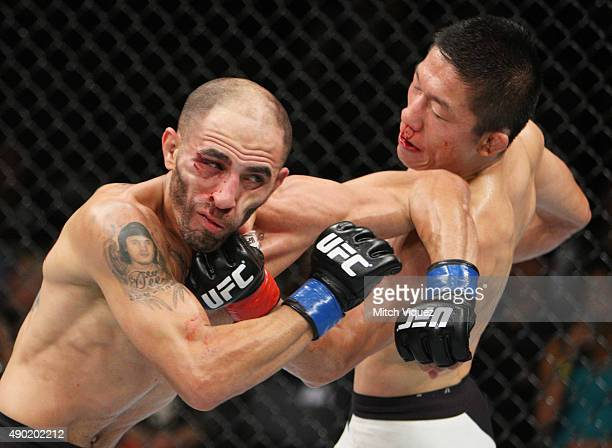 Kyoji Horiguchi of Japan punches Chico Camus of the United States of America in their flyweight bout during the UFC event at the Saitama Super Arena...