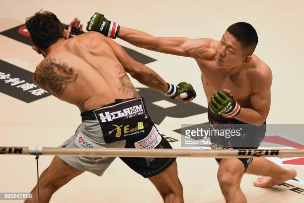 Kyoji Horiguchi of Japan punches Gabriel Oliveira of Brazil in the bantam weight bout during the RIZIN Fighting World Grand-Prix 2017 2nd Round at...