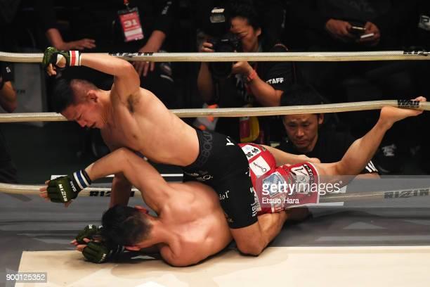Kyoji Horiguchi of Japan punches Shintaro Ishiwatari of Japan in the bantam weight GP final bout during the RIZIN Fighting World Grand-Prix 2017...