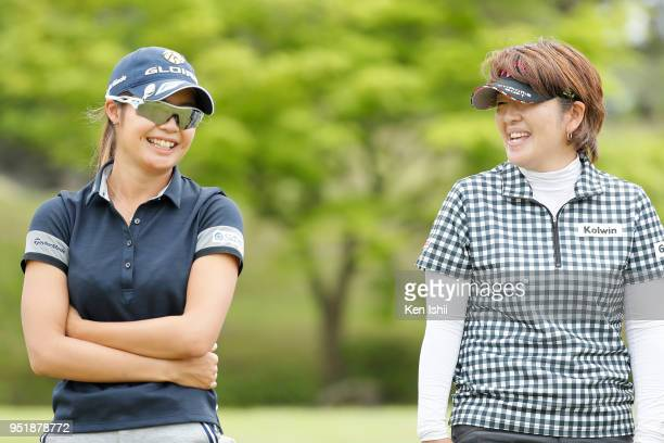 Kyoka Matsumori and Hiroko Fukushima of Japan talk on the 8th green during the first round of the CyberAgent Ladies Golf Tournament at Grand fields...