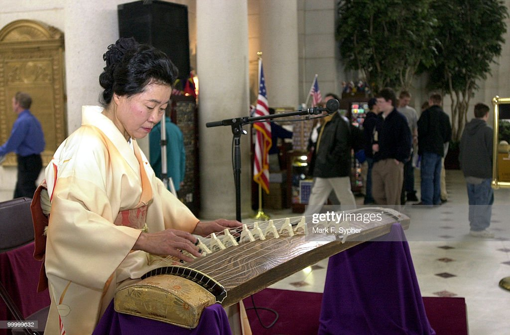 Kyoko Okamoto plays a koto, a six foot long, thirteen-string zither, for an audience in Union Staion on Wednesday. Okamoto is a certified koto teacher at the Ikuta school of Koto, in Japan.