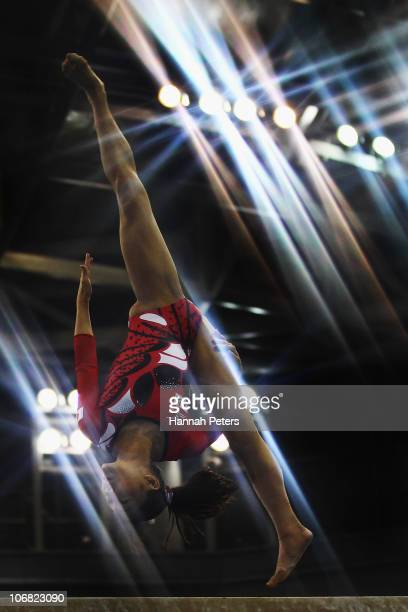 Kyoko Oshima of Japan competes in the Women's Team Final beam discipline at the Asian Games Town Gymnasium during day two of the 16th Asian Games...