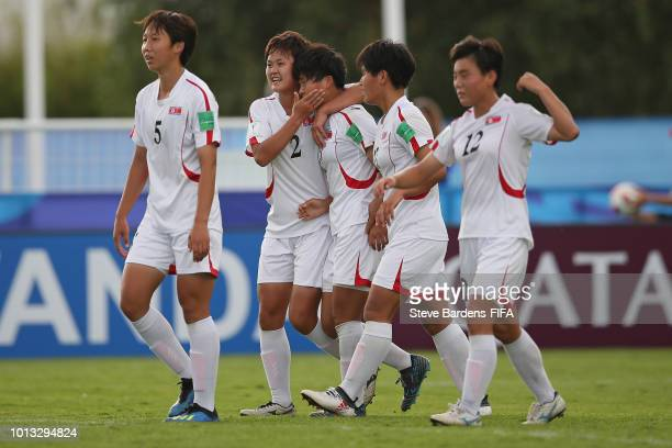 Kyong Yong Kim of Korea DPR celebrates scoring the winning goal with her team mates during the FIFA U20 Women's World Cup France 2018 group B match...