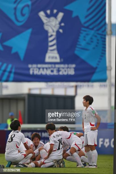 Kyong Yong Kim of Korea DPR is mobbed by her team mates after scoring the winning goal during the FIFA U20 Women's World Cup France 2018 group B...