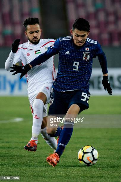 Kyosuke Tagawa of Japan and Omar Sandouqa of Palestine compete for the ball during the AFC U23 Championship Group B match between Japan and Palestine...