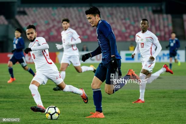 Kyosuke Tagawa of Japan drives the ball during the AFC U23 Championship Group B match between Japan and Palestine at Jiangyin Sports Center on...
