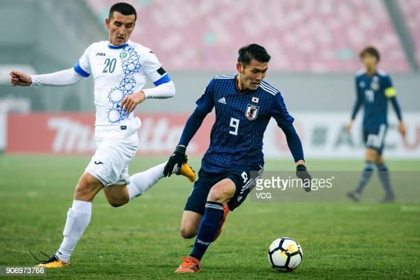 Kyosuke Tagawa of Japan follows the ball during the AFC U23 Championship quarterfinal match between Japan and Uzbekistan at Jiangyin Stadium on...
