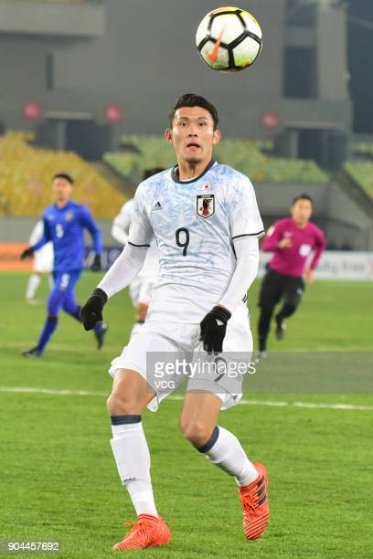 Kyosuke Tagawa of Japan heads the ball during the AFC U23 Championship Group B match between Thailand and Japan at Jiangyin Stadium on January 13...