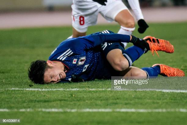 Kyosuke Tagawa of Japan lies on the ground during the AFC U23 Championship Group B match between Japan and Palestine at Jiangyin Sports Center on...