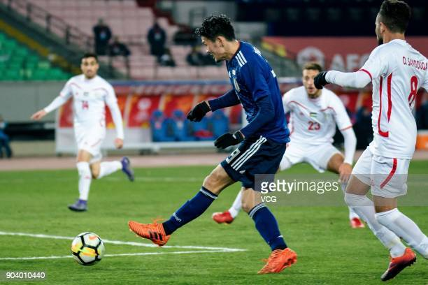 Kyosuke Tagawa of Japan shoots the ball during the AFC U23 Championship Group B match between Japan and Palestine at Jiangyin Sports Center at...