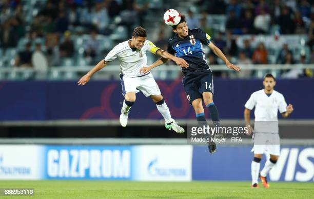Kyosuke Tagawa of Japan wins a ball out of the air against Rolando Mandragora of Italy during the FIFA U20 World Cup Korea Republic 2017 group D...