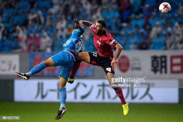 Kyosuke Tagawa of Sagan Tosu and Matej Jonjic of Cerezo Osaka compete for the ball during the JLeague J1 match between Sagan Tosu and Cerezo Osaka at...