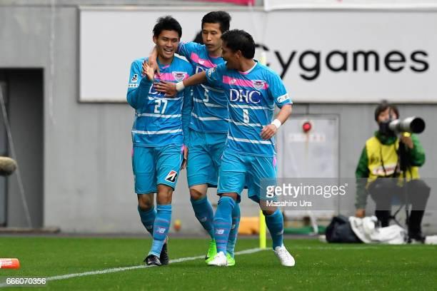 Kyosuke Tagawa of Sagan Tosu celebrates scoring his side's third goal with his team mates Kim Min Hyeok and Masato Fujita during the JLeague J1 match...