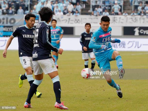 Kyosuke Tagawa of Sagan Tosu takes on Nagisa Sakurauchi and Shunsuke Nakamura of Jubilo Iwata during the JLeague J1 match between Sagan Tosu and...