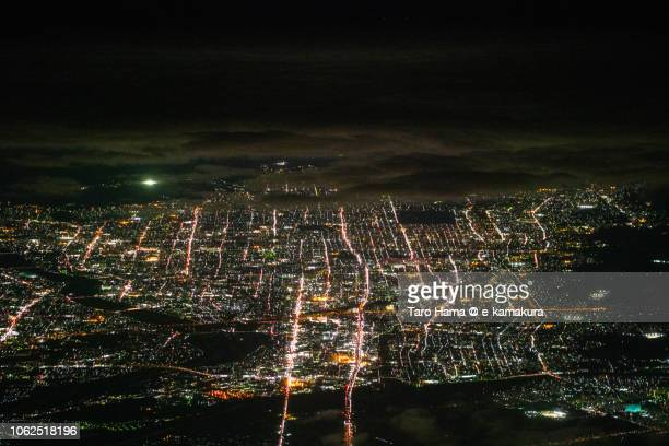 Kyoto city in Kyoto prefecture in Japan night time aerial view from airplane