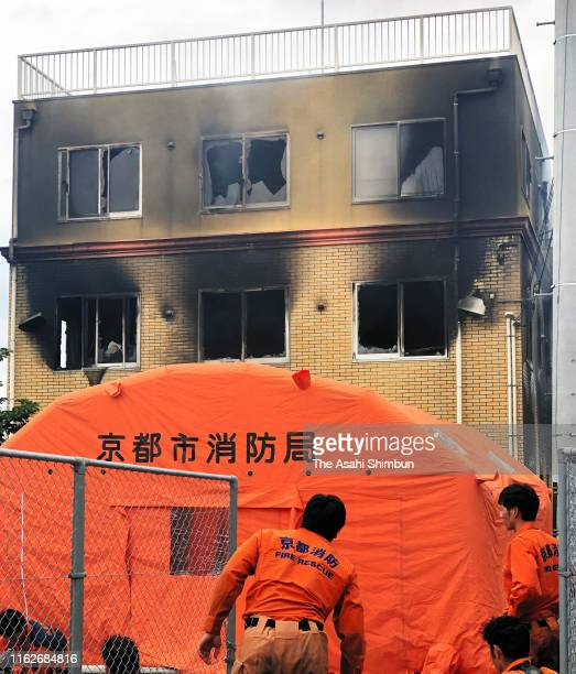 Kyoto Fire Department crews set up a tent near the burnt studio of Kyoto Animation Co on July 18 2019 in Kyoto Japan Police suspect an arsonist set a...