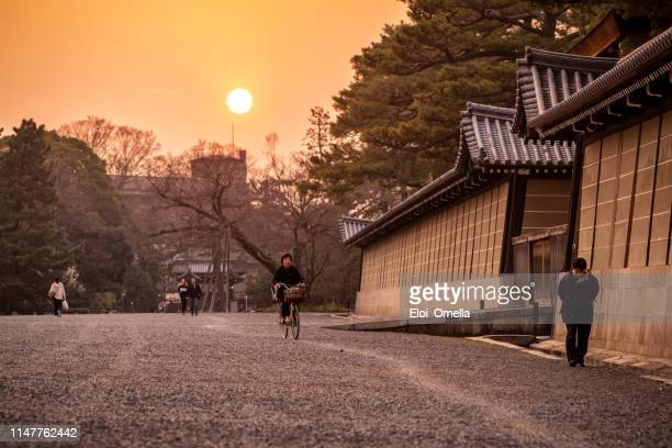 kyoto imperial palace outdoors at sunset. japan - kyoto prefecture stock pictures, royalty-free photos & images