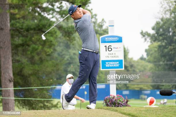 Kyoung-Hoon Lee tees off on the 16th hole during the first round of the Wyndham Championship golf tournament at Sedgefield Country Club in...