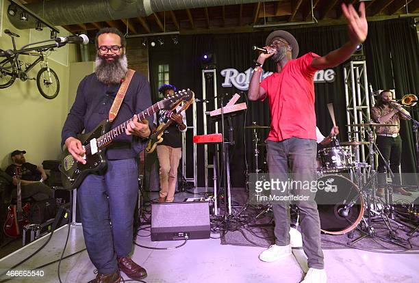 Kyp Malone and Tunde Adebimpe of TV on the Radio perform at the Rolling Stone day party at Mellow Johnnies Bicycle shop on March 17 2015 in Austin...